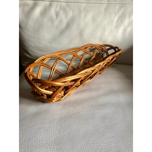 Vintage hand made in the French campaign woven wicker baguette bread basket.