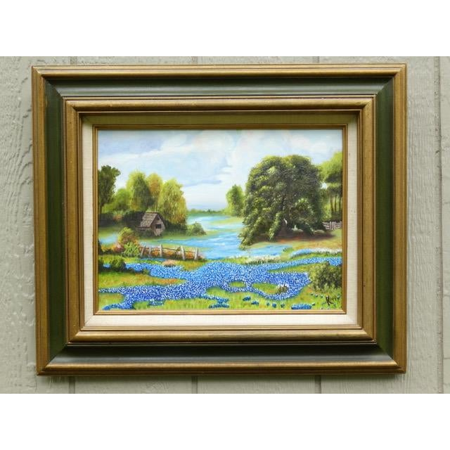 A charming countryside landscape original oil painting of bluebonnets and rolling hills, circa 1960s. Excellent attention...