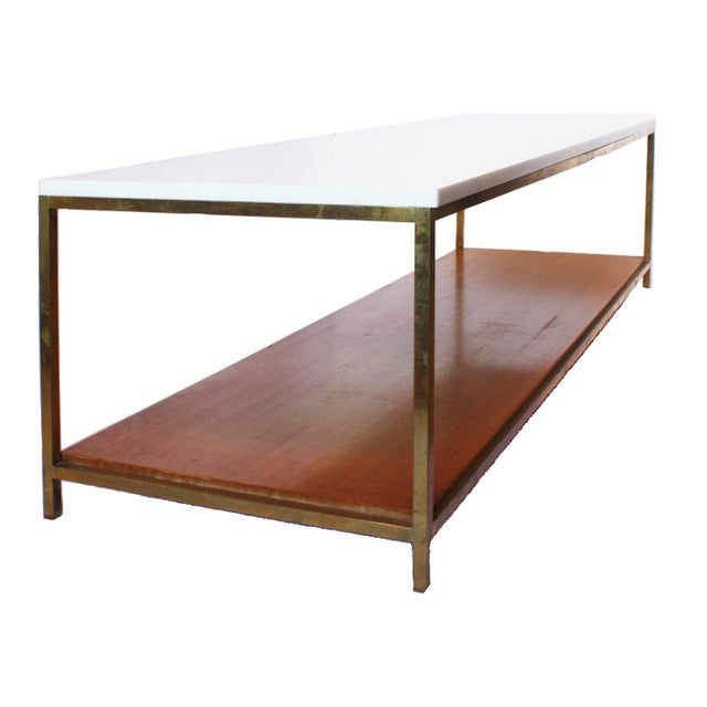 Stunning Mid-Century Paul McCobb rectangular coffee table with vitrolite glass top and wood shelf. All on a thin bronze...