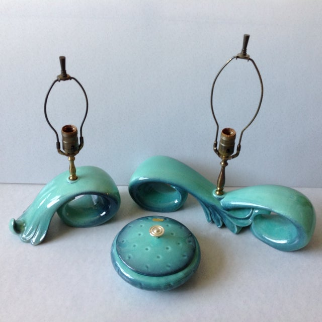 "An iconic Royal Haeger pottery lamp set in a high gloss sea foam green and blue glaze. Small lamp measures 10"" wide x 4""..."