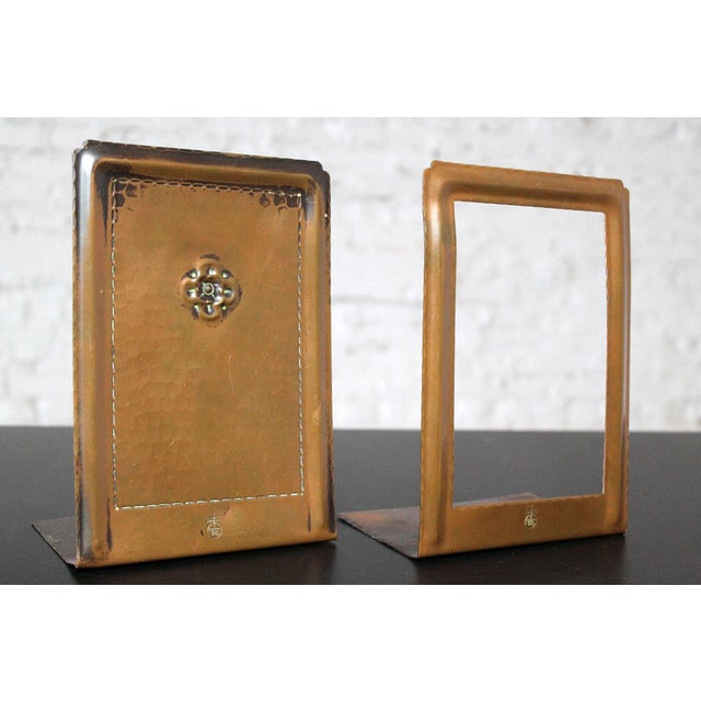 Very nice pair of Arts and Crafts bookends of hammered copper by Roycroft. This handsome pair consists of rectangular...