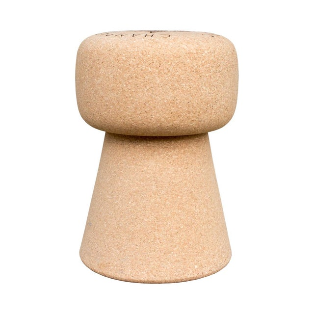 The original and exclusive champagne cork stool that also doubles as a chic side or drinks table. Crafted of real cork...