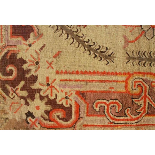 An antique Central Asian Samarkand rug with a beautiful floral medallion surrounded by a floral and scrolling vine border....