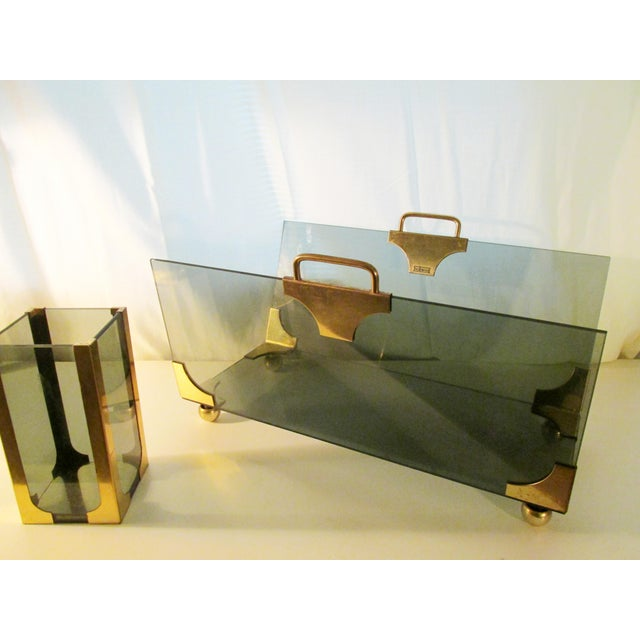 """Sleek log holder set in smoky glass with brass details, marked with sticker: """"Beckwood"""" Heavyweight set, circa 1970's...."""