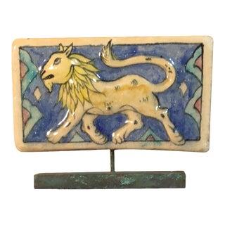 Vintage Persian Ceramic Lion Tile on Bronze Base For Sale