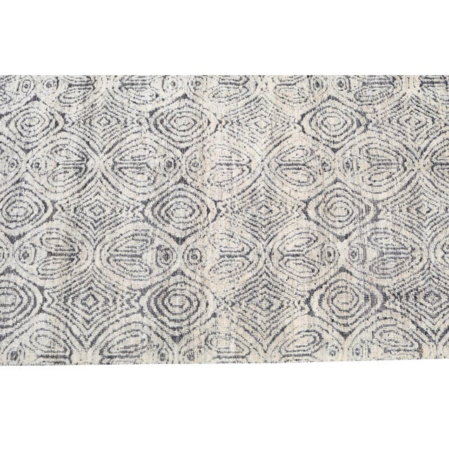 This is a hi-low, detailed pattern moroccan style rug. It is flat-woven with raised areas in white. Colors are black and...