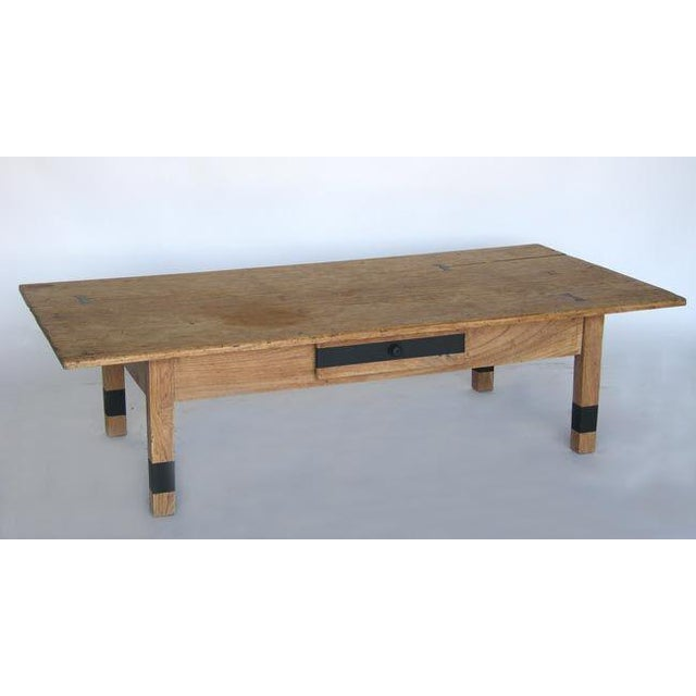 Early 20th Century Guatemalan cedro and cipres wood coffee table with drawer and painted stripes. Hand forged iron...