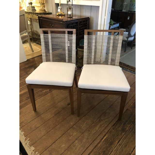Beautifully made pair of contemporary side chairs having raffia rope woven seats and raffia rope entwined backs that are...