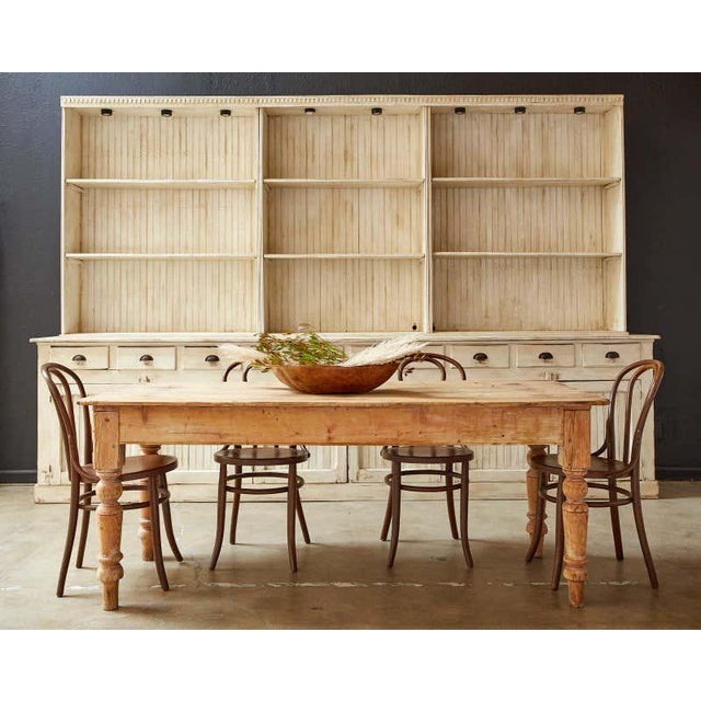 Rustic 19th century American country farmhouse dining table featuring a beautifully aged pine patina with a scrubbed...