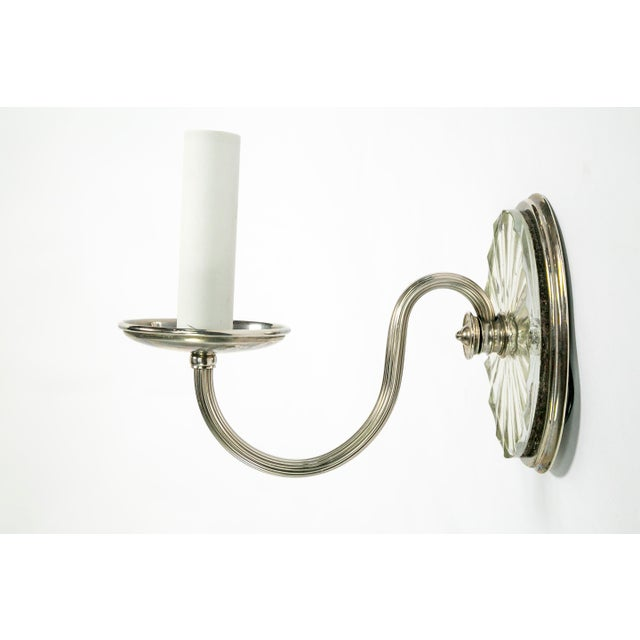 This gorgeous pair of silver plated sconces by E.F. Caldwell c. 1910-1920, have a cut mirror backplate that looks even...