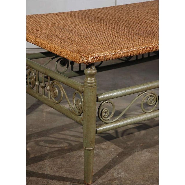 This chaise, done by the Heywood Wakefield Company in the 19th century. It has a new caned top, the base is green painted...