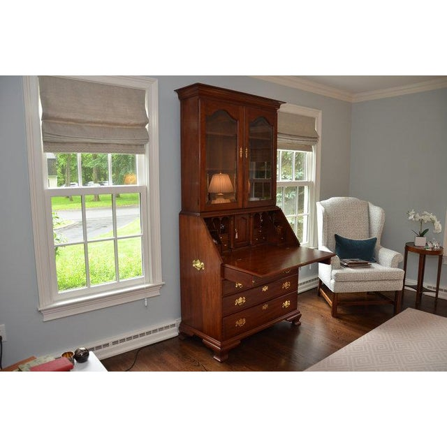 Henkel Harris John Hancock secretary desk is a classic style that is part desk, part storage and display piece. Made of...