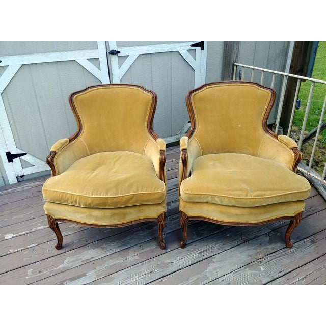Item offered is a wonderful vintage pair of Meyer, Gunther & Martini Louis XV Bergere carved wood French arm chairs with...