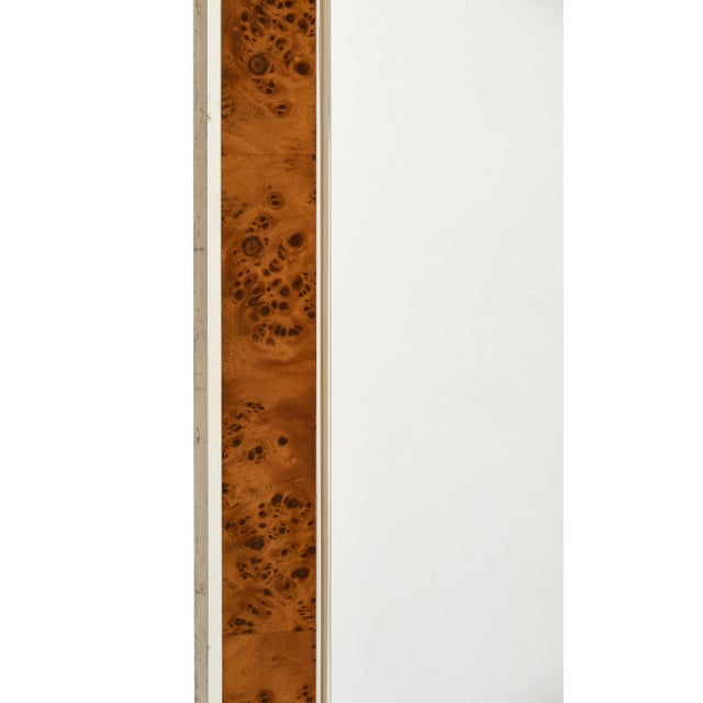 Mid-century French burled ash rectangular mirror with brass interior and exterior trim. The mirror itself is original to...