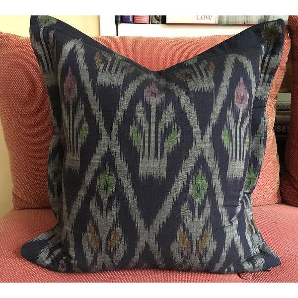 Indigo Ikat Handwoven Thailand Pillow with navy linen back. The fabric is from Thailand and the pillow is crafted in New...