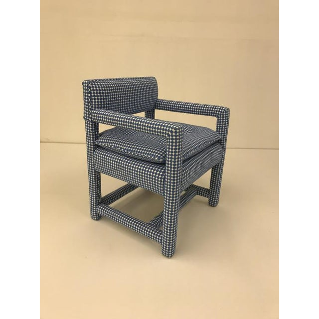The Morehead Chair is a first quality market sample that features a Blue Fabric in a Tight Back Style.