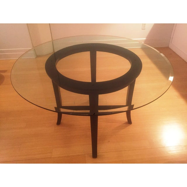 I'm selling my near mint condition Crate and Barrel dining table that seats 4-5 people. The top is thick glass with a...