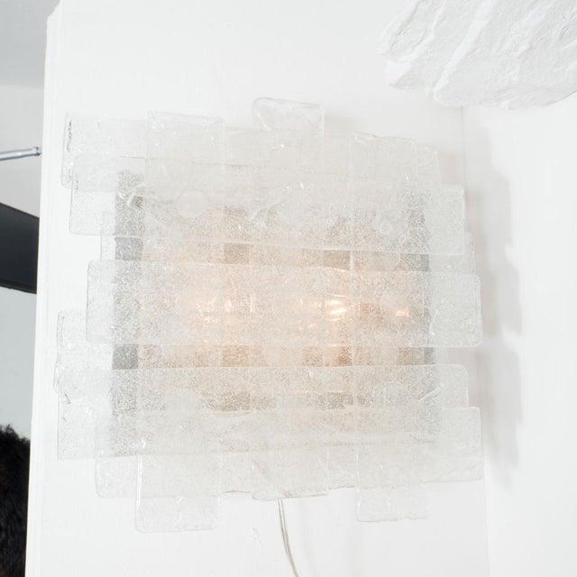 "Pair of crosshatch design Murano glass sconces by Mazzega. Designer MAZZEGA Origin: Italy Circa: 1960 Dimensions: 11.75""..."