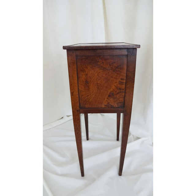 Antique French Three Drawer Commode, circa 1820. Inlaid diamond pattern on surface and drawers with a metal knob. Square...