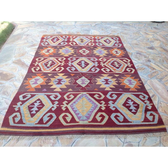This beautiful vintage handwoven kilim is approximately 60 years old. It is handmade of wool and cotton in all natural...