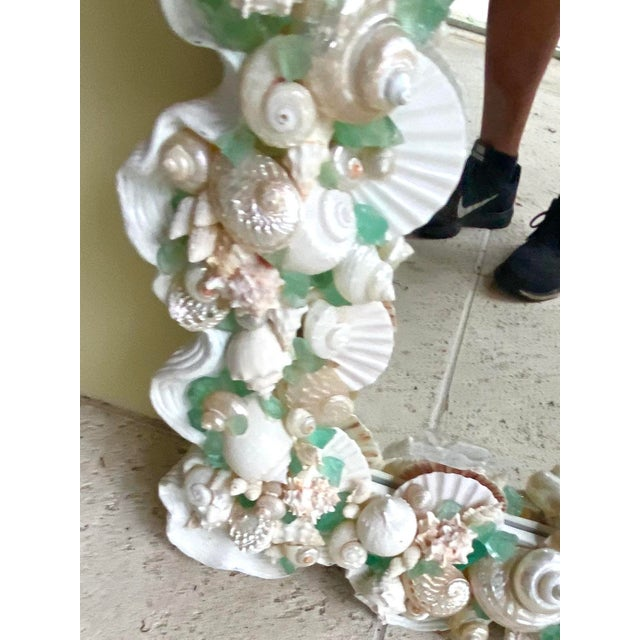 Incredible artist made shell and sea glass mirror. Super composition of really special shells that rest in a painted...