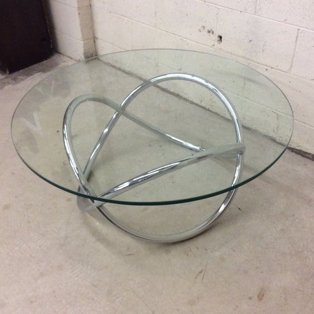 Another every day mid century round glass top coffee table with a cool tubular infinity shape base. Excellent condition....