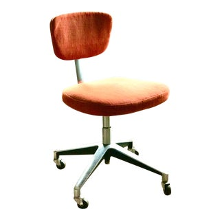 1960's Modern Orange Rolling Office Chair For Sale
