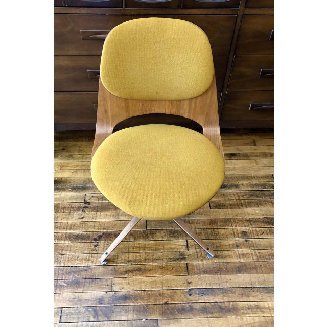 Fantastic shaped bentwood desk chair designed by George Mulhauser and manufacturer by Plycraft, United States 1950. The...
