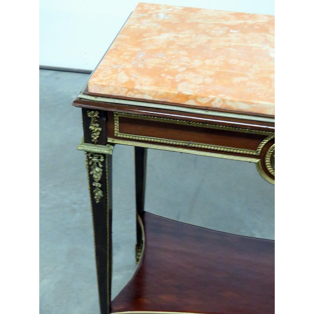 Regency style marble top desk, attributed to Forest, with bronze mounts. Made in the early 20th century.