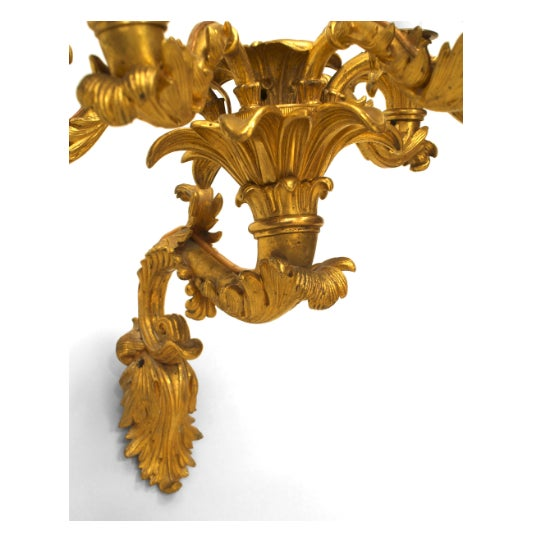 Pair of Charles X (circa 1835) gilt bronze wall sconces with 5 scroll arms emanating from a center light