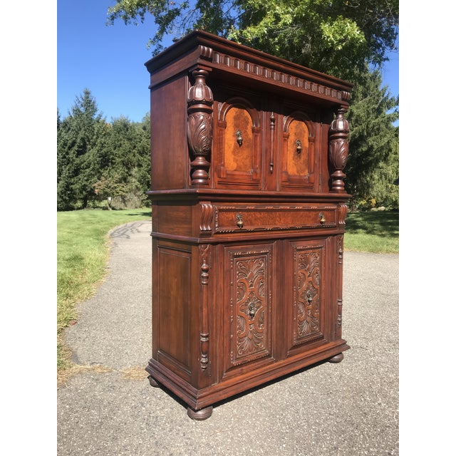 High end upright dining cabinet made by Berkey and Gay and Grand Rapids Michigan. Very intricate carvings and details...
