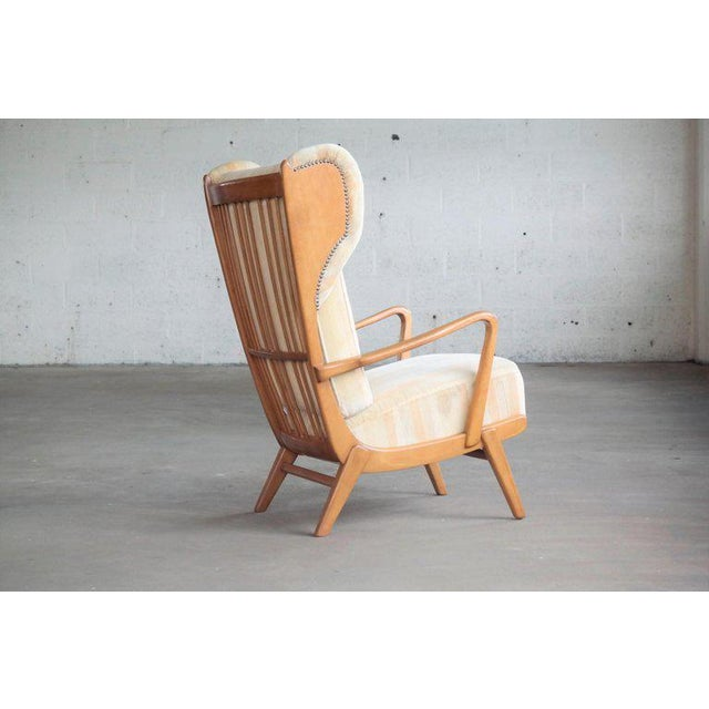 Mid-Century Modern Danish Midcentury Wingback Lounge Chair With Exposed Sides For Sale - Image 3 of 13
