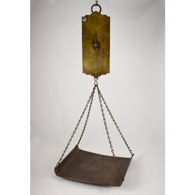 A hanging mercantile circular spring scale along with a rustic galvanized steel tray, circa early to mid 1800's. The scale...