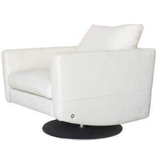 Modernist White Swivel Lounge Chair With Brush Steel Base For Sale