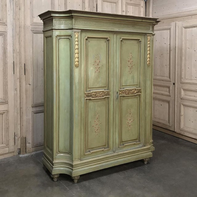 Antique Italian Neoclassical Painted Armoire has been beautifully carved with exceptional foliate motifs across the facade...