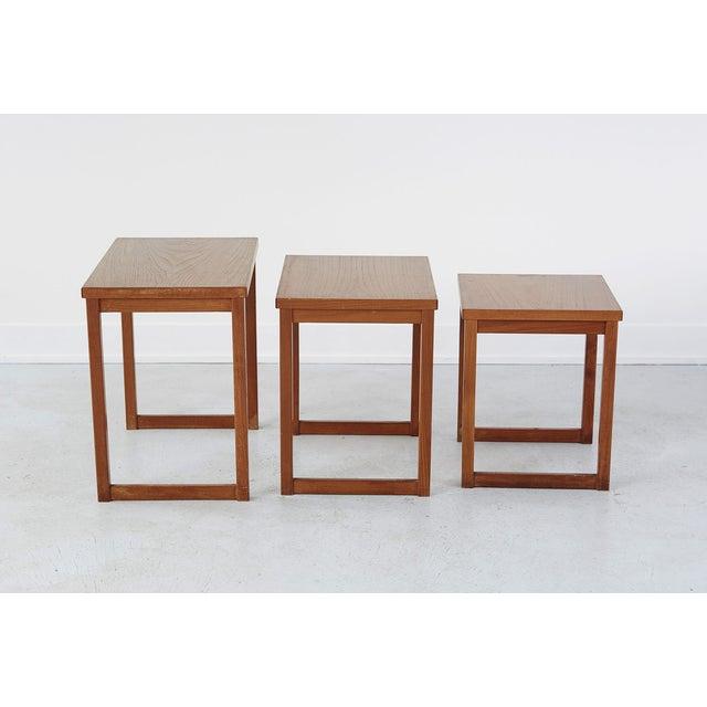 "set of three nesting tables designed by Kai Kristiansen for Vidbjerg Møbelfabrik wood largest table 19"" h x 19 ½"" w x 13..."