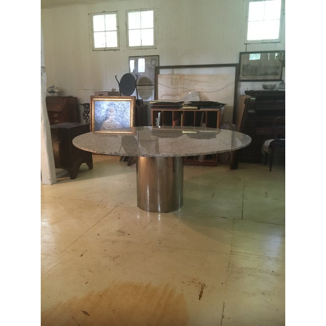 Amazing condition and grand in Scale! Stunning dining table in the style of Brueton. Similar tables at Rouse Home sell for...
