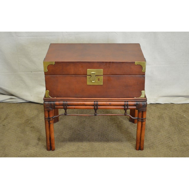 STORE ITEM #: 15659-ax Craftwork Gilt Campaign Style Lidded Accent Chest on Bamboo Frame AGE/COUNTRY OF ORIGIN – Approx 20...
