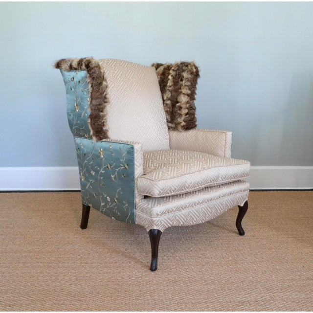 This stately vintage wingback chair with French legs was stripped down to the hardwood frame and rebuilt using all new...