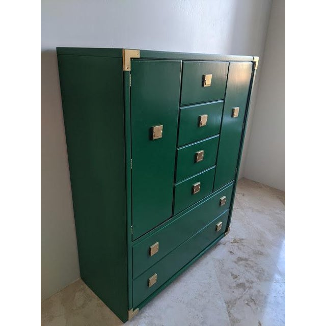 Mid century Thomasville campaign highboy dresser. Six drawers and two cabinet doors with two shelves on each side....