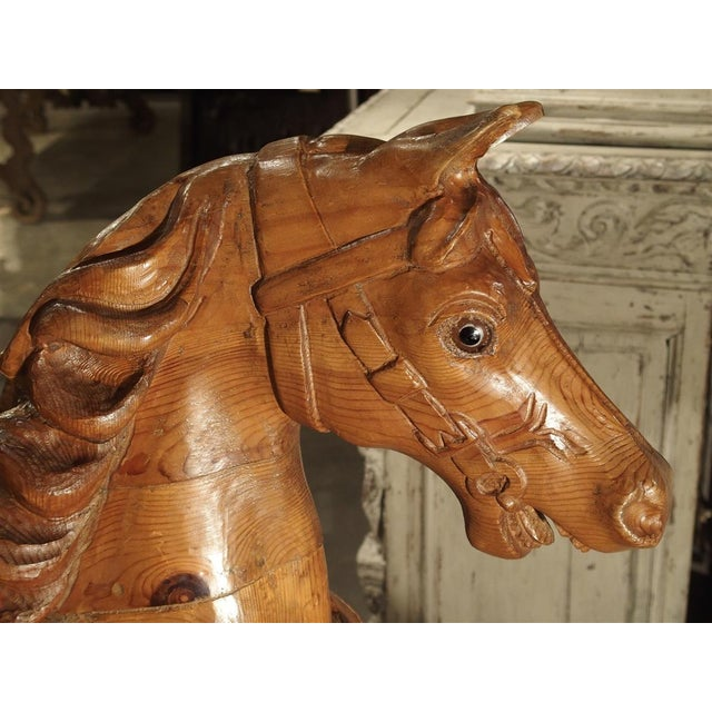 From Spain, this beautifully hand carved pine wood horse has been mounted upon a contemporary black marble stand with a...