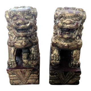 A Pair- Maroon and Gilded Gold Foo Dogs Bookends For Sale