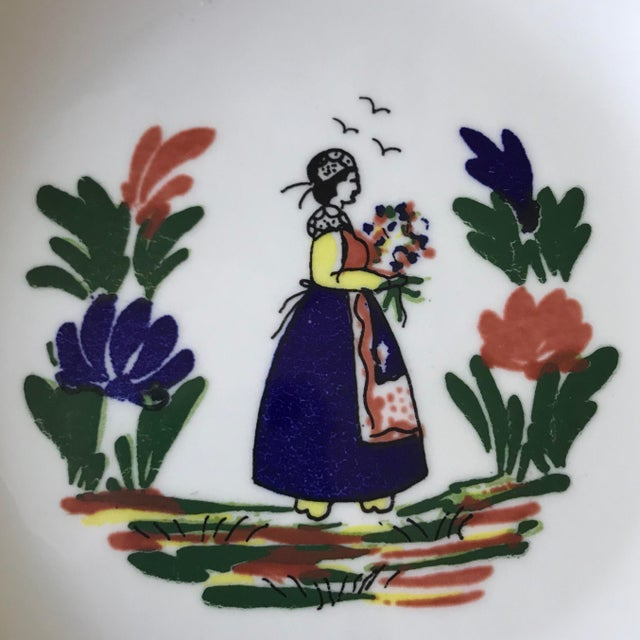 Beautiful dish/shallow bowl. Made in France by Varages. In the style of Quimper with woman in traditional folk dress in a...