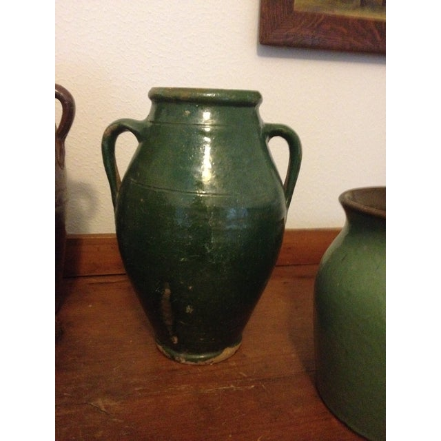 Double handle green Turkish pottery jar with original blemishes as shown. Use in a grouping or by itself