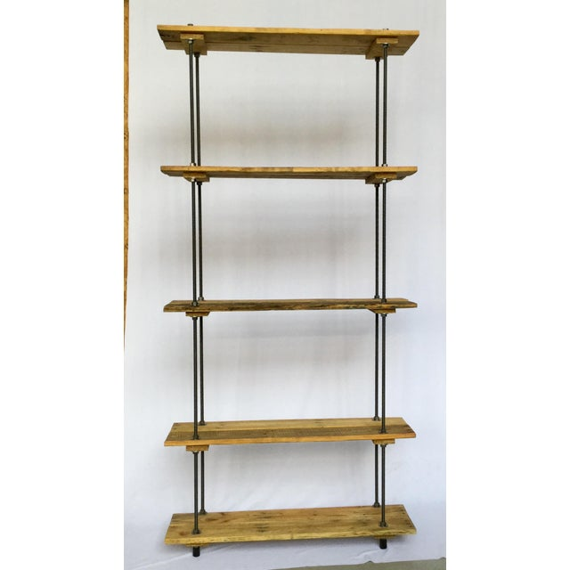 5 Shelves and the depth is between 10 to 11 inches. Fully adjustable between shelves. Industrial metal and wood at its...