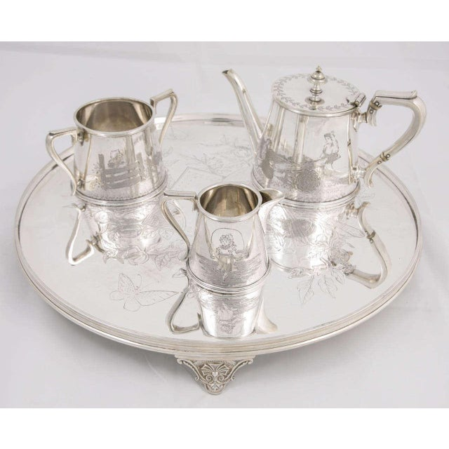 Silver plated three-piece child's tea set and tray with Kate Greenway scenes, circa 1890s, perfect for a child's nursery...