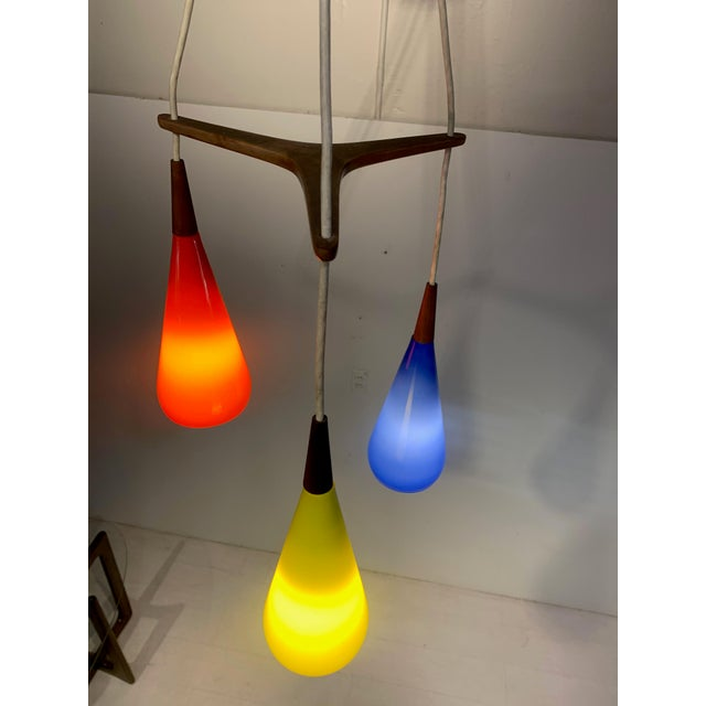 Prescolite Pendant Hanging Swag Lamp This vintage chandelier pendant lights from Prescolite. Three primary colored lights...