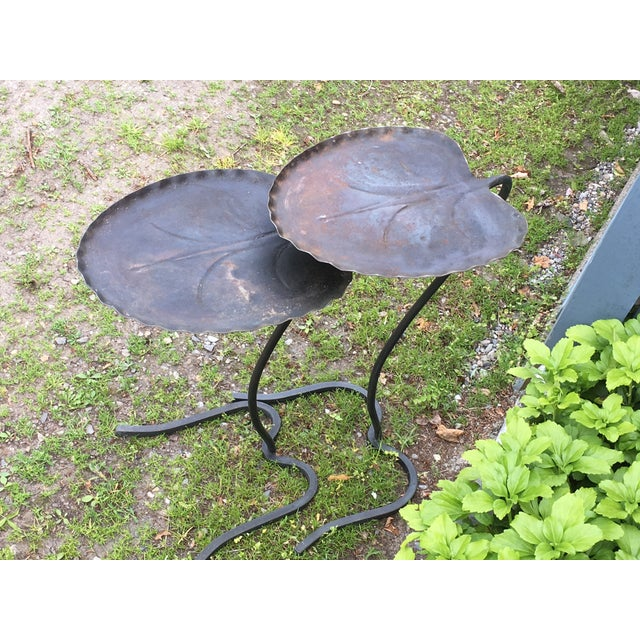 Terrific as found pair of Salterini Leaf form side tables. We have left the aged patinated dark blue-black surface which...