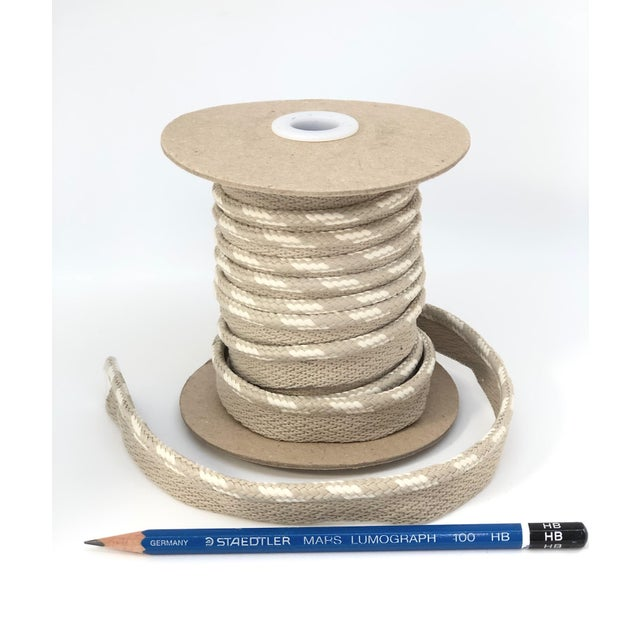 "One, 10.5 yard spool of 1/4"" braided cord with flange. Cording colors: creamy white with warm neutral flange color. Flange..."