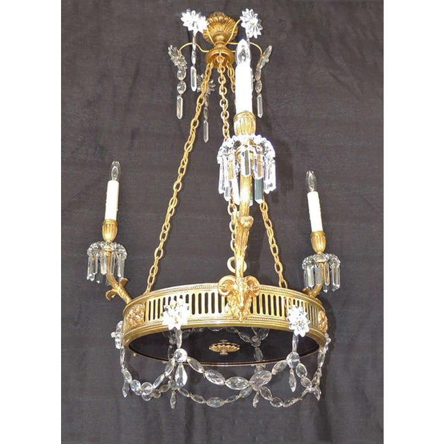 This chandelier was made in France in a Russian style and is made of brass and bronze with a deep violet glass bottom and...